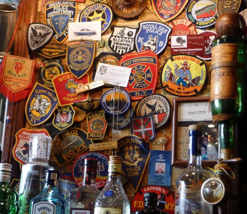 Badges on the wall at Harry's New York Bar