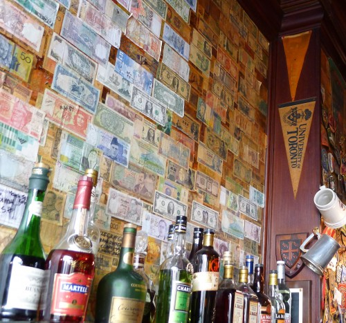 Banners and money behind the bar